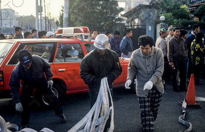 mhc-ghe 195 s3-15   Wearing only what they had on at the time the quake struck, many mucked in with the overstretched emergency services in a desperate bid to fight the fires.   Keywords: destruction, kobe, earthquake, japan, fire, men, firefighter, hoses, red, car