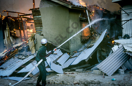 mhc-ghe 195 s3-25   Underequipped and overstretched firefighters did their best to tackle huge blazes, often single-handed.   Keywords: destruction, kobe, earthquake, japan, fire, firefighter, hose, water