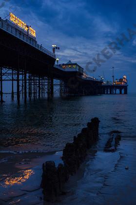 mhc-can 813 d387   Brighton Palace Pier at dusk   Keywords: brighton, pier, dusk, blue, lights, water, calm, helter skelter, groines, groynes, reflection