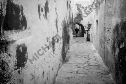 mhc-tun 401 s004   Back alley, Hammamet, Tunisia.   Keywords: Tunisia, alley, black and white, empty, distant figure, narrow, mysterious