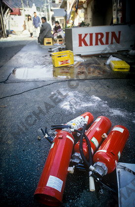 mhc-ghe 195 s1-11   With the fire brigade stretched to the limit most people were compelled to fight fires with whatever came to hand.   Keywords: destruction, kobe, earthquake, japan, extinguishers, red, fire, kirin, crate