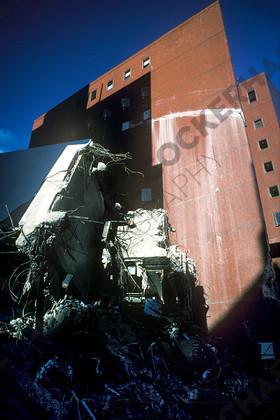 mhc-kim 195 s1-6   A high rise sideswiped an adjacent tower block as it collapsed in the quake.   Keywords: earthquake, kobe, japan, fire, destruction, devastation, towerblock, topple, damage, sideswipe, blue, terracota