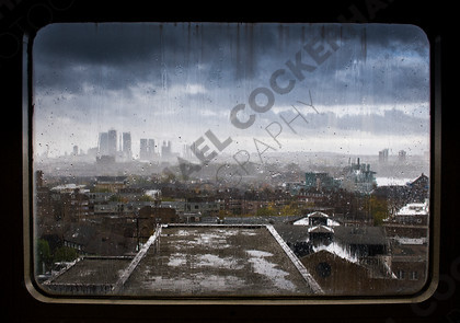 elt-wed 1108 d320   Docklands skyline through rainy window from London Bridge area.   Keywords: Rain, skyline, London, Docklands, Canary Wharf, window, rain, brooding sky, depressed, depression, shut in