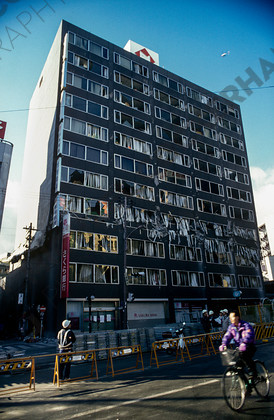 mhc-ghe 195 s5-36   Many modern buildings suffered collapse about a third of the way up their structures, with the top floors dropping onto lower ones.   Keywords: earthquake, kobe, japan, fire, destruction, office block, highrise